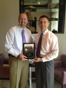 SWFL Select Coach Greg Franks presents appreciation plaque to Castle Group CEO James Donnelly. Thank you Castle Group!